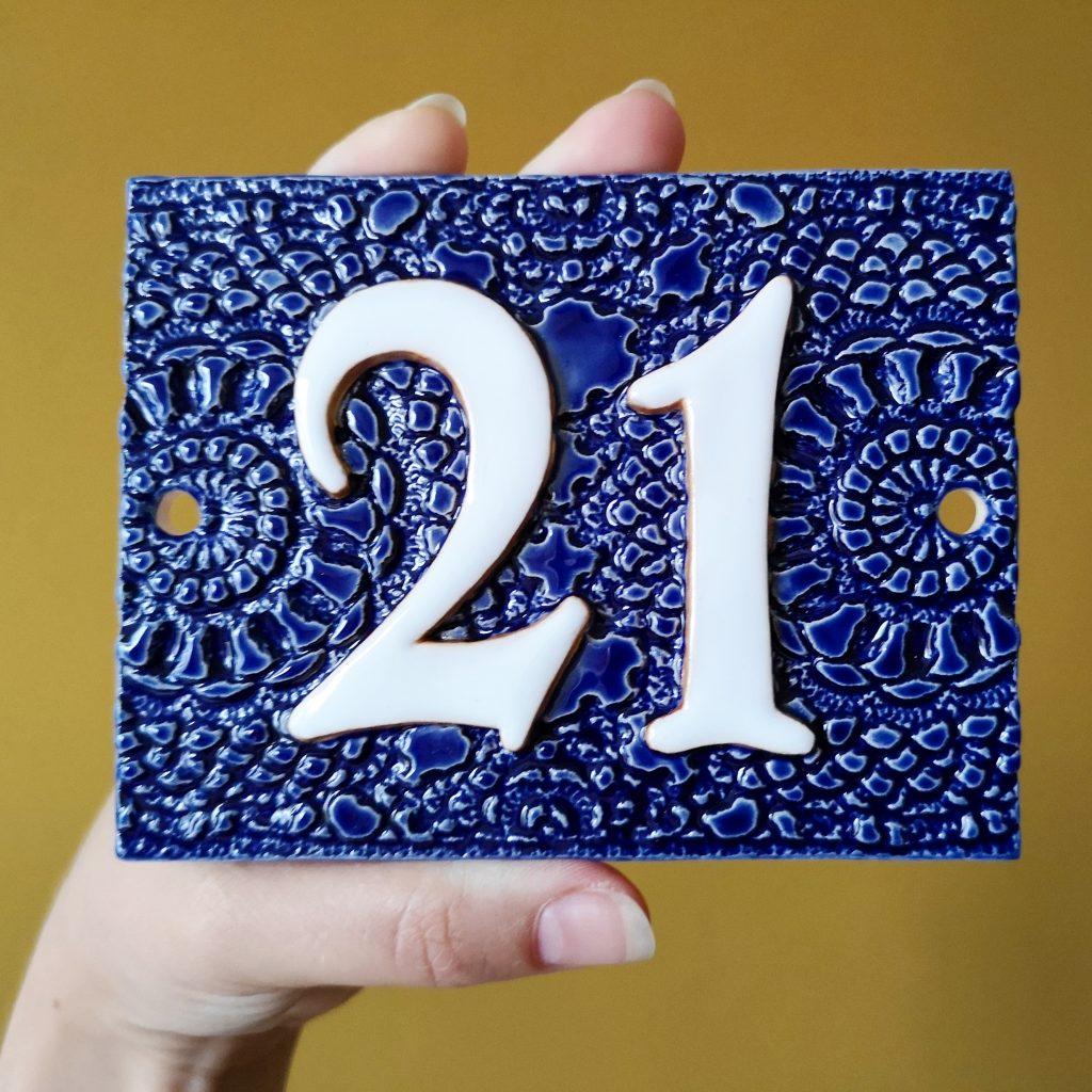 Huisnummer 21 blauw
